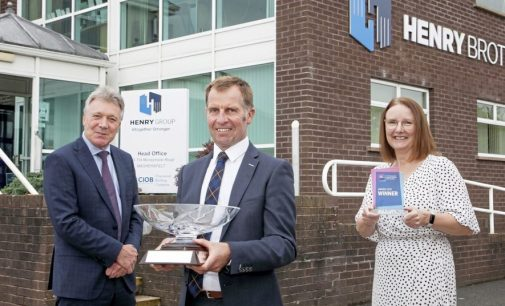 Construction firm Henry Brothers collects top responsible business award